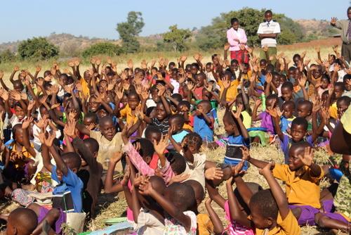 Grace Schools students raising their hands to receive Jesus!