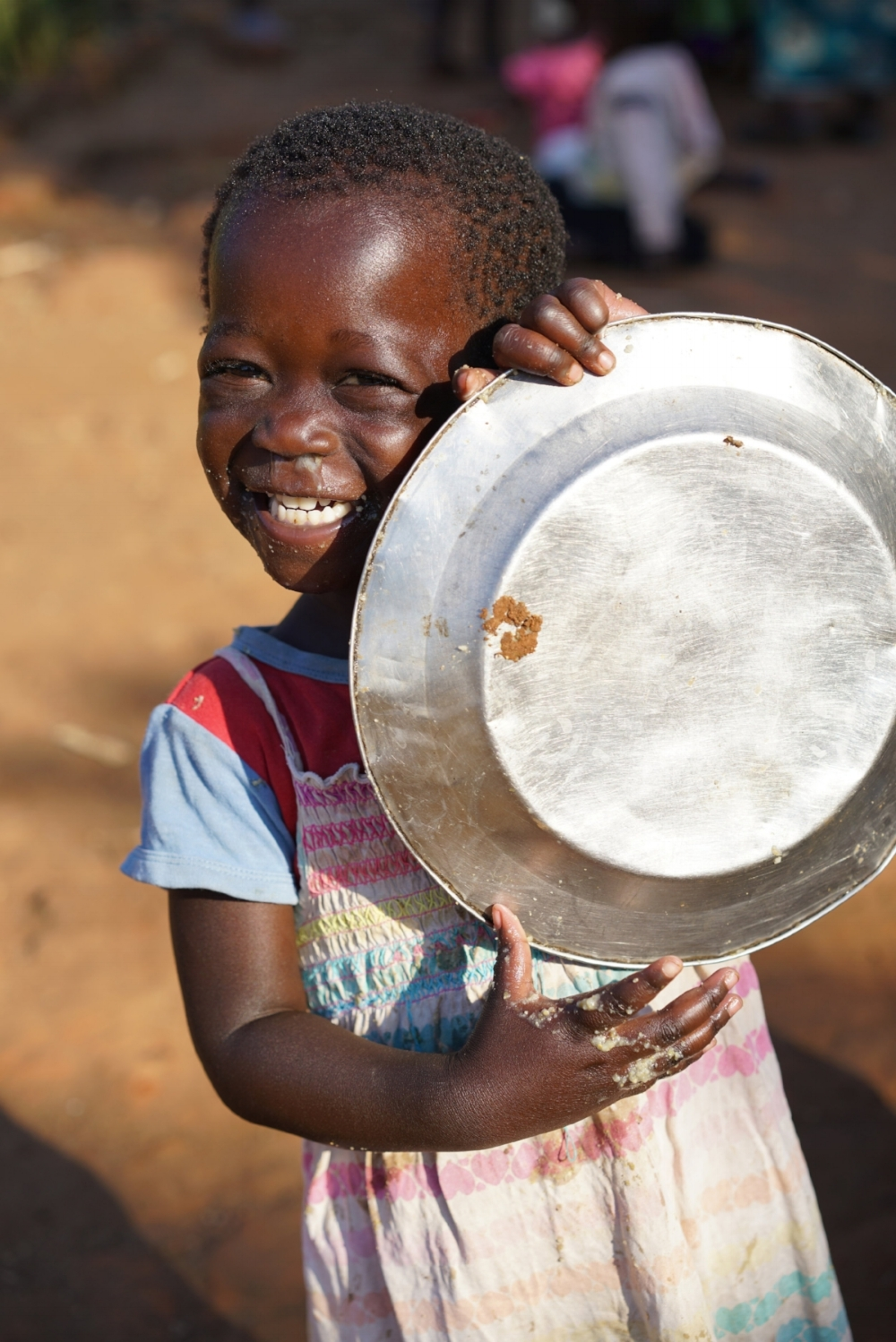 Clean plates and big smiles bring our hearts joy! Imagine how many more plates of food and smiles the future holds as we increase the Grace Center!