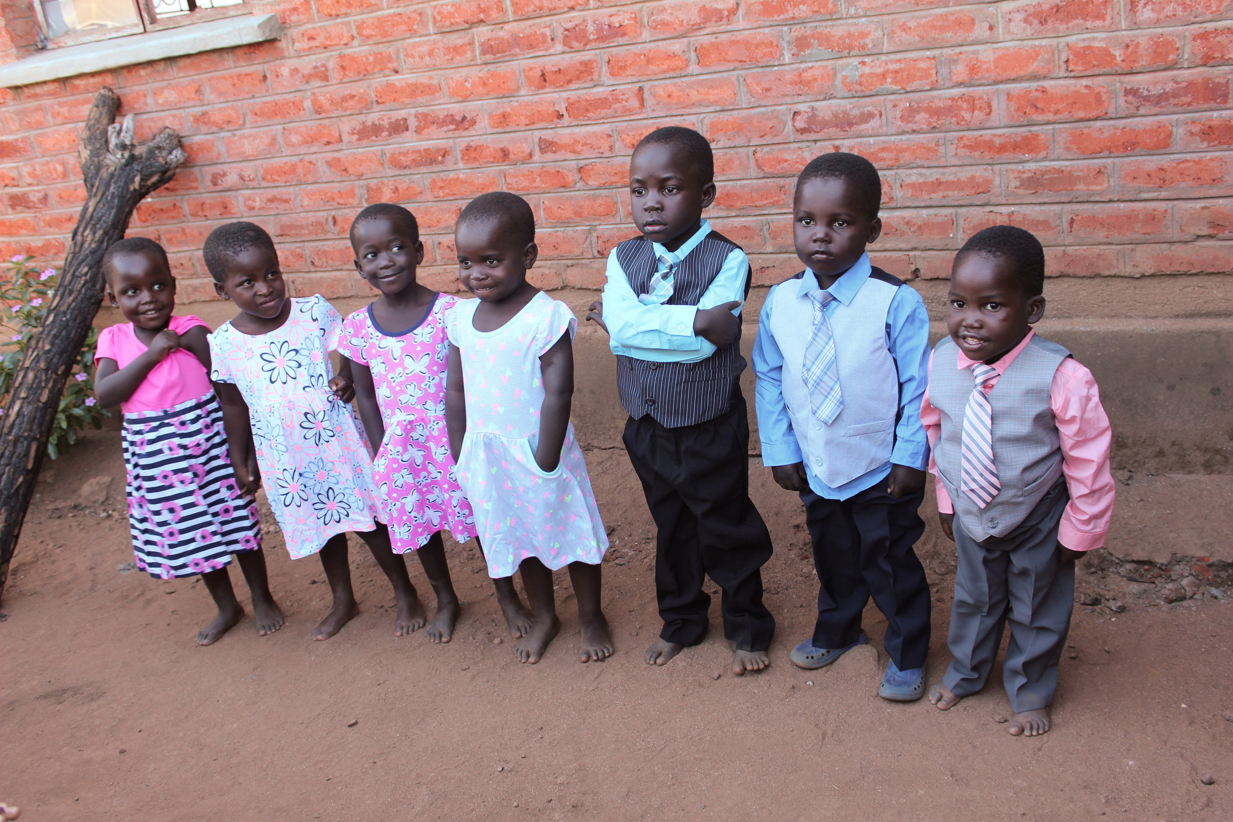 Dressed to the nines! From left to right: Leya, Janet, Esther C,, Esther J,, Laban, Jachai and Timmy Too.