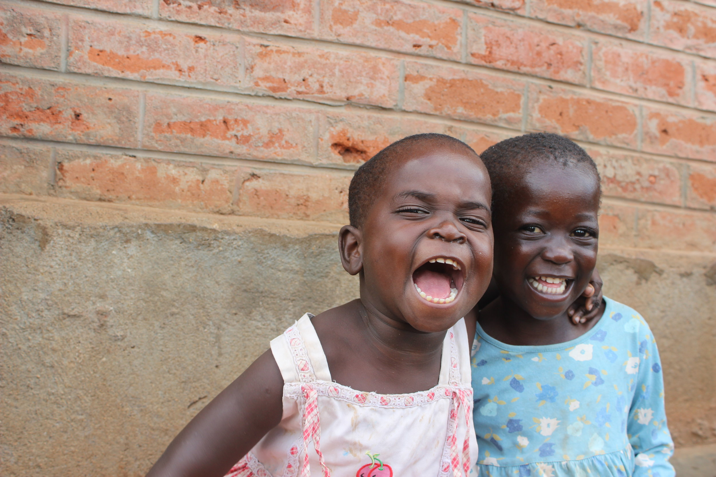 Our children's smiles shine with pure LOVE!