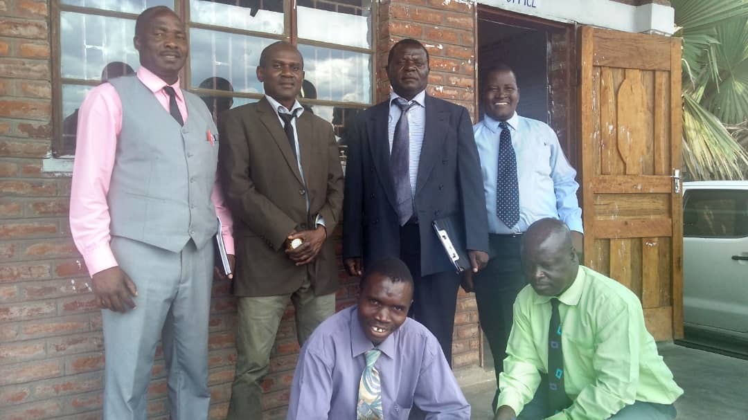 Mr. Henry Chadza, in the green shirt, with the government inspection team.