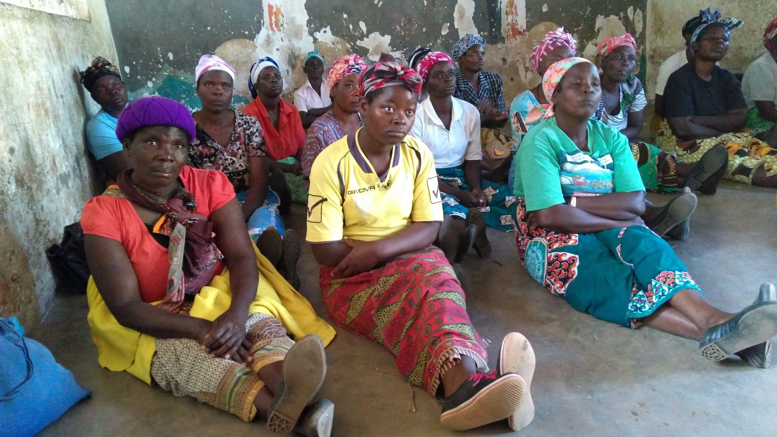 Mothers from Timothy's and Patricia's Homes learning how to watch for fevers and when to take kids to the hospital.