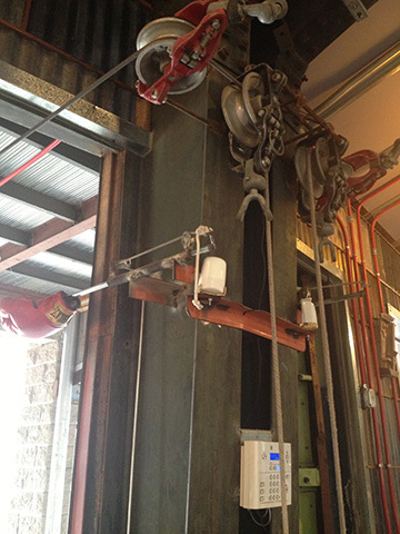 pulley systems repurposed to open door