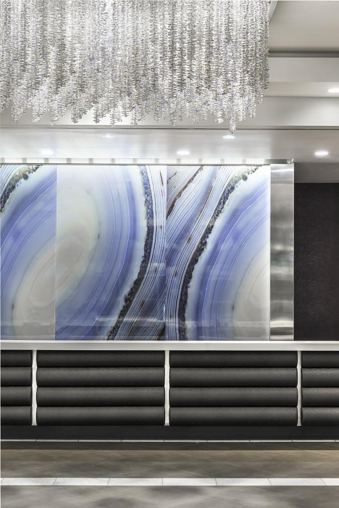 Lobby Desk at Desert Blue Resort in Las Vegas, NV Designed by Design Poole, Inc in Winter Park Florida