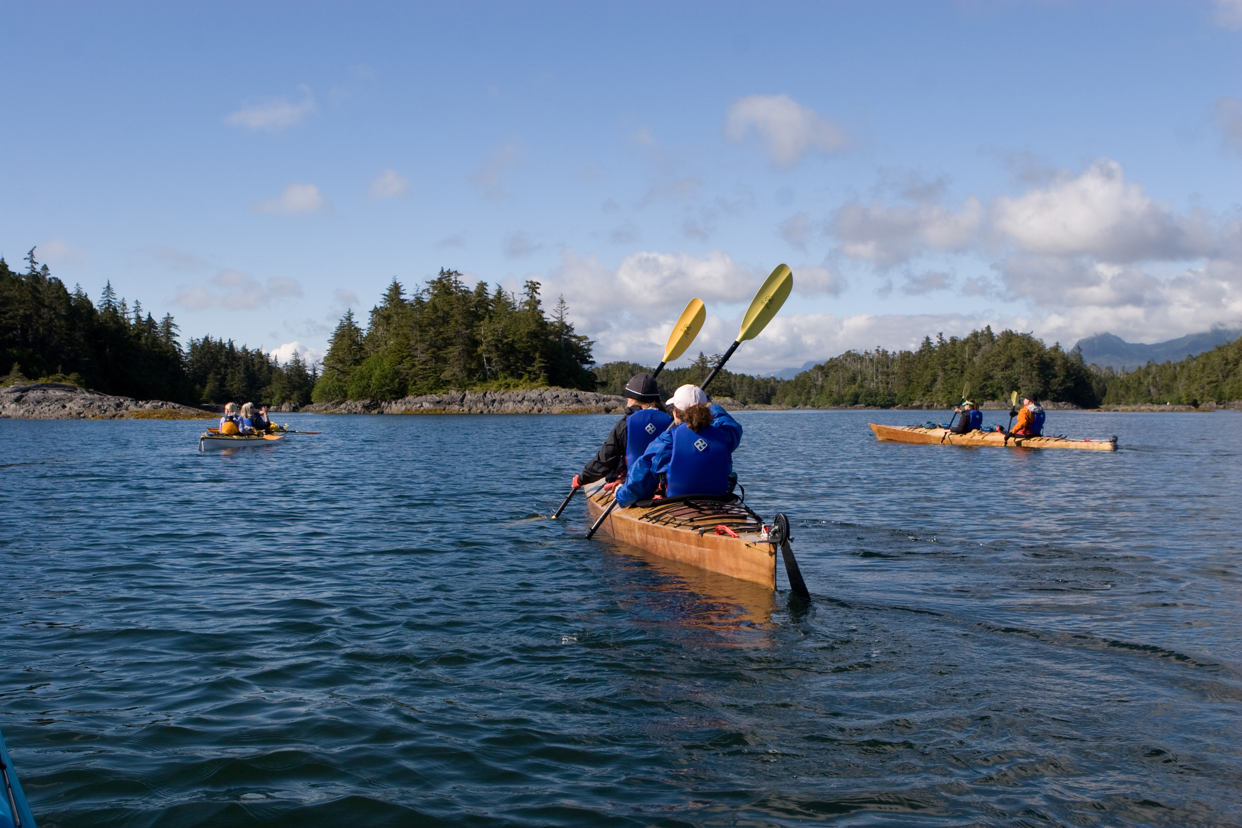 Paddlers use cs to navigate the channels between the small islands of the Myriad Islands in Alaska.