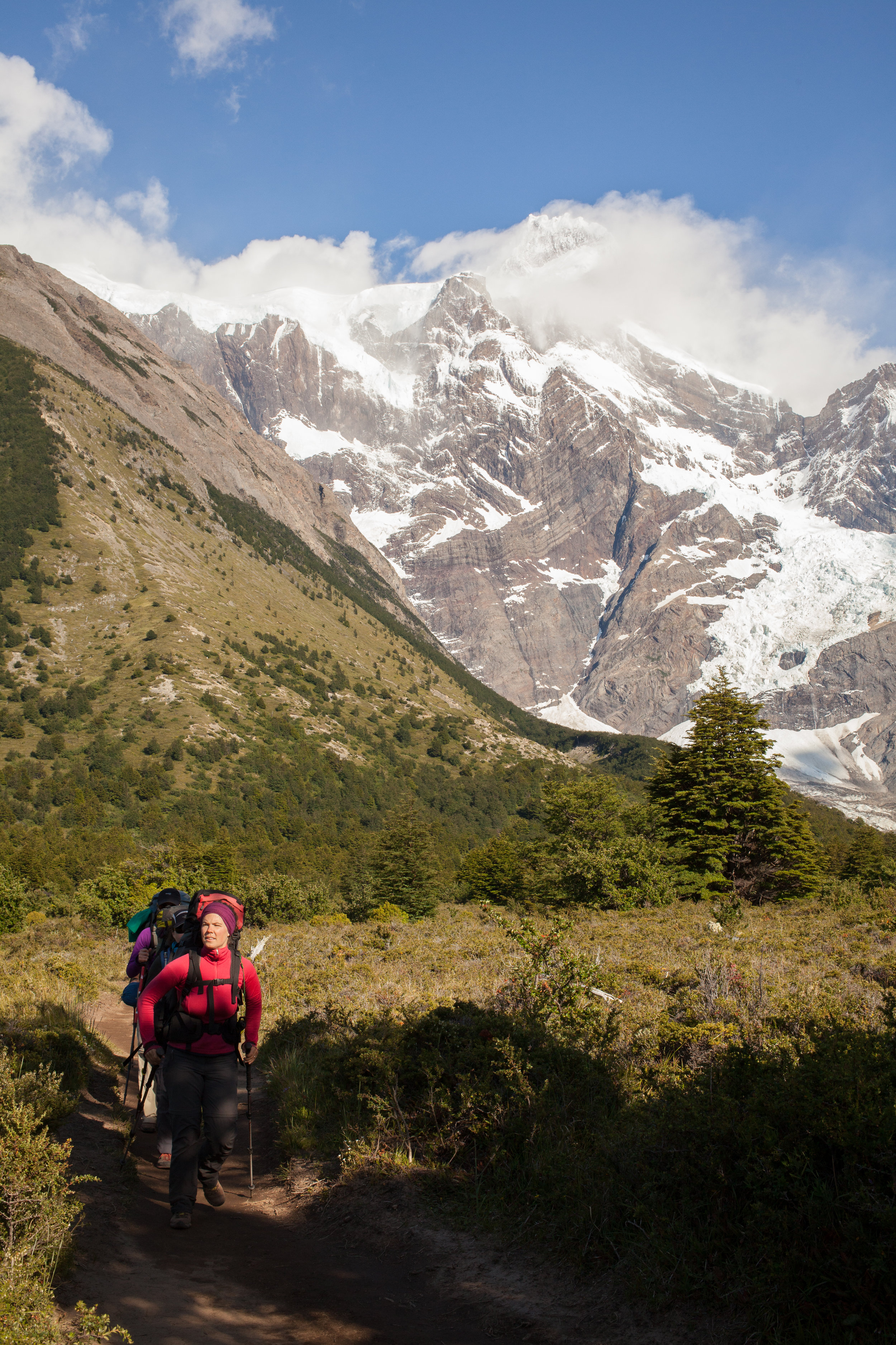Callie leads the way from Italian Camp with the Franc és Glacier in the background.