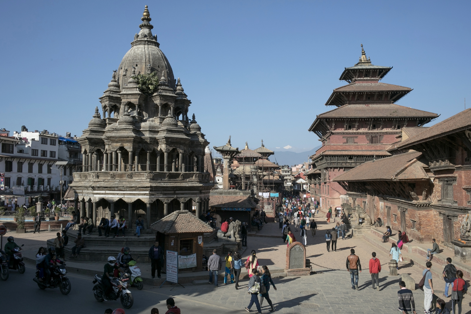 Patan is an area known for its artisans.  The area has many of the traditional wood shops and a museum of statues.