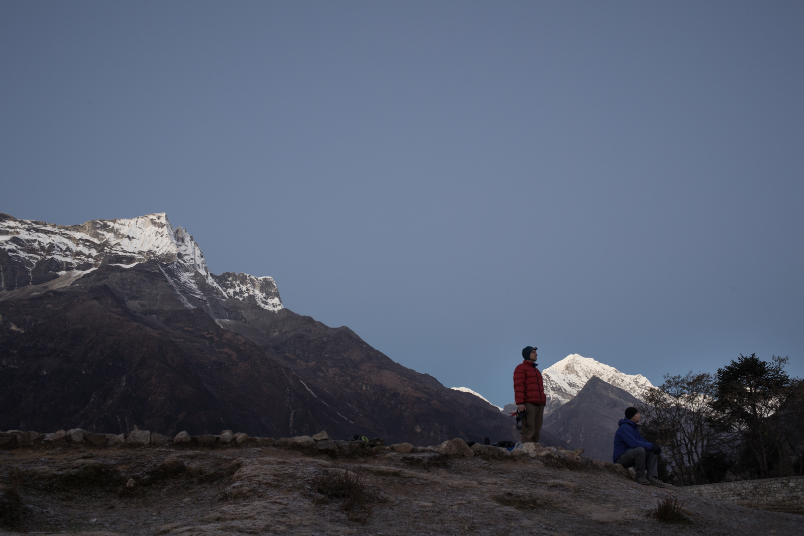 Ambrose and Russ watch the horizon as the sun rises and brings light to the Everest valley.