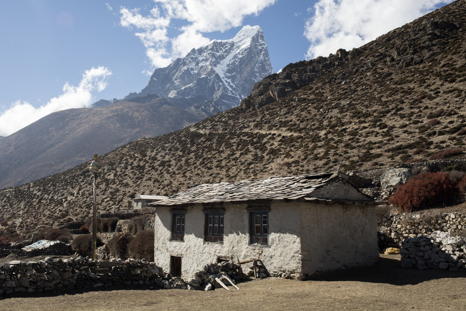 Taboche 6,495 m / 21,309 ft.  The village of Dingboche which sits at an elevation of 14,410 ft. We took a rest day to acclimatize to the elevation gain and the altitude. I was beginning to feel some effects of altitude, a slight headache, and a little nausea.  I made sure to rest a lot during our stay at Dingboche. Rest, hydration, repeat.