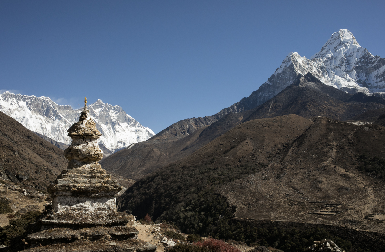 An old stupa is aged by the weather. On this side of the valley the landmarks feel ancient, as though it was less touched by tourism and more in line with what the local people created for themselves.