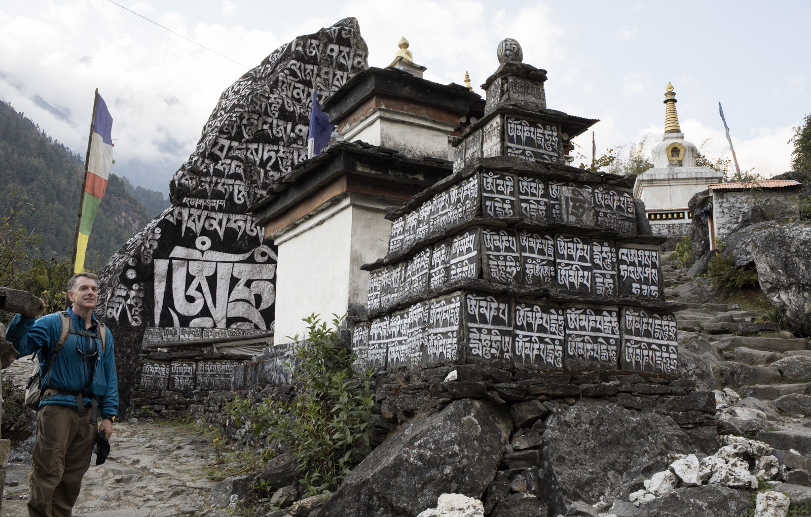 Ambrose waits near the painted Mani stones and Chortens to direct us around the stones clockwise.  We pass the rocks on the left and can repeat the mantra, Om Mani Padme Hum.