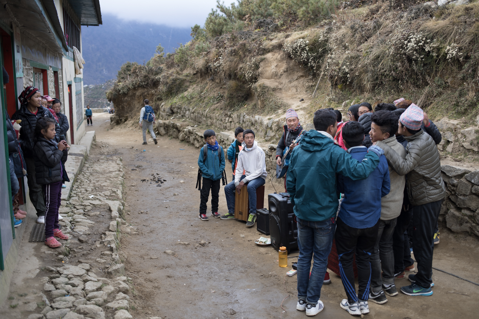 A group of young kids gathered together on the outskirts of town to pay music for a small group of locals.  I ran into them as I returned from an acclimatization hike.  They had mics, electric guitars and were holding each other as they sang.