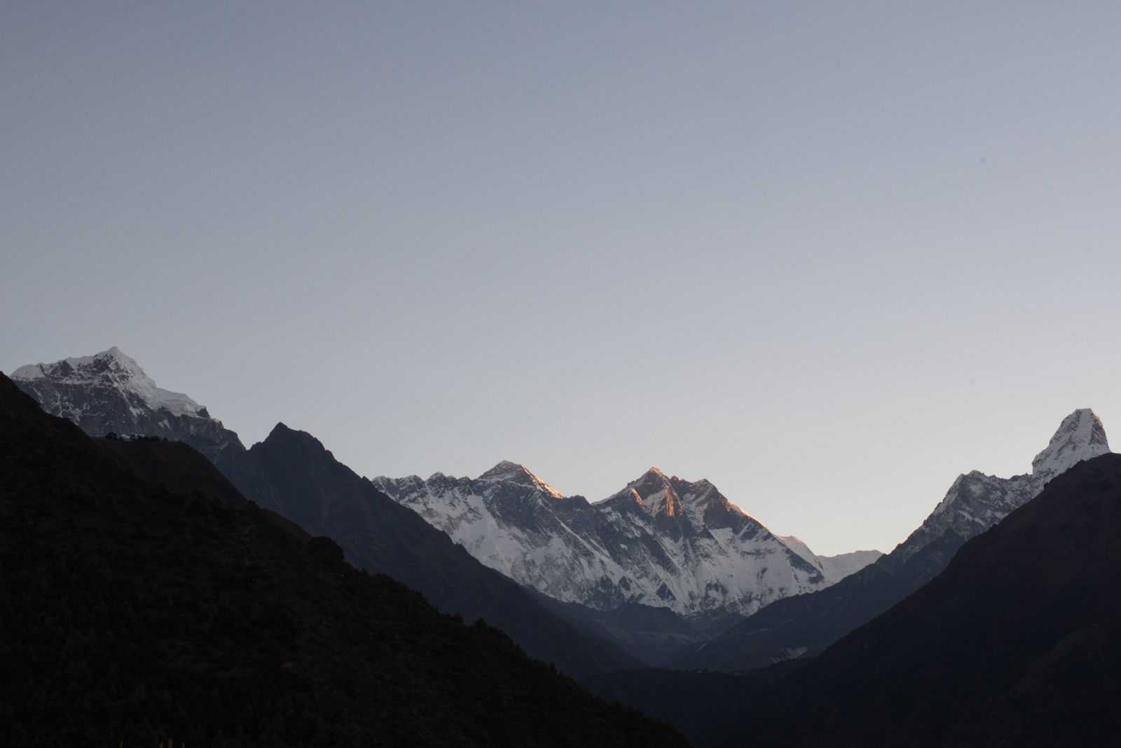 Alpine glow.  Left to Right: Taboche 6,495 m / 21,309 ft, Nuptse 7,861 m / 25,791 ft, Everest 8,848m / 29,029 ft,  Lhotse 8,516 m / 27,940 ft, Shartse 7,457 m / 24,465 ft  Ama Dablam 6,856 m / 22,493 ft. (Elevation credit: PeakFinder)