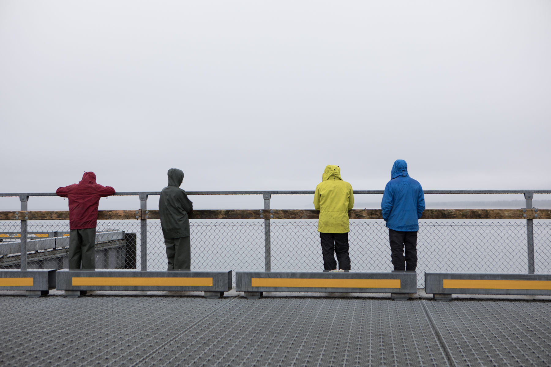 Rain jackets. Waiting for our water taxi. The weather predictions were wet: rain, with showers in the evening.  The first two days of our trip would be a lesson in wetness management and an appropriate introduction to the temperate rainforest of the Tongass National Forest.