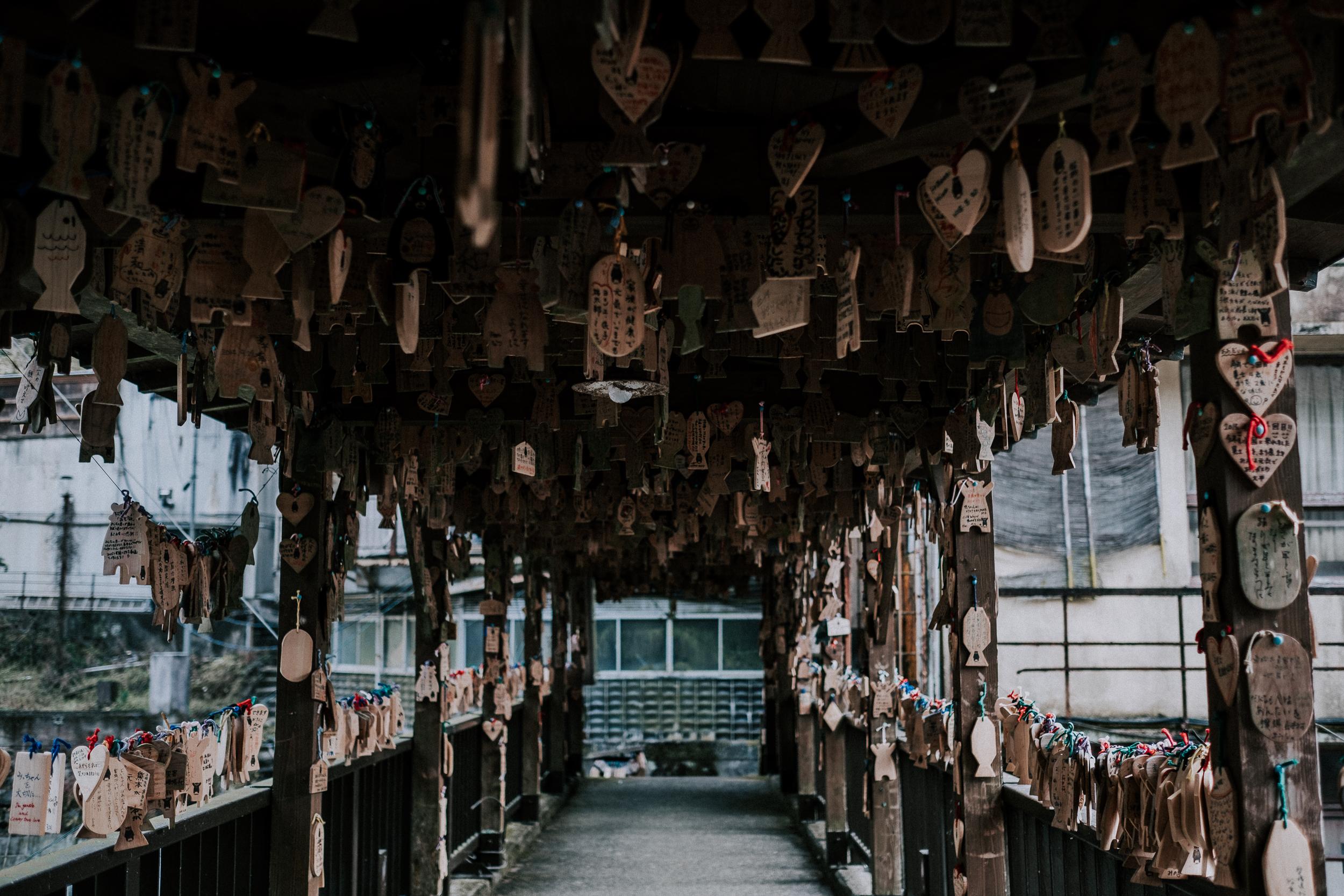 Prayers and wishes in a bridge over Kurokawa.