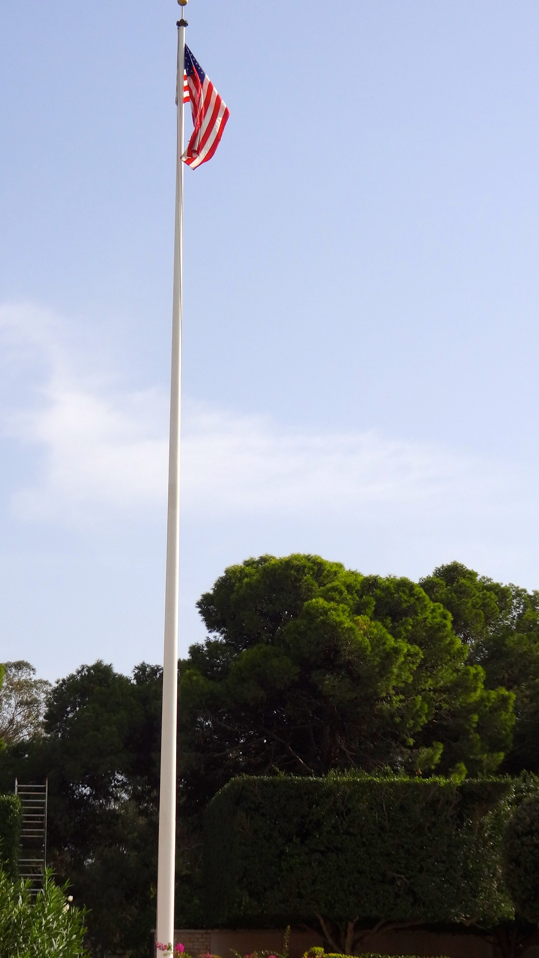 US flag flying permanently over the graves of US WWII Killed in Action