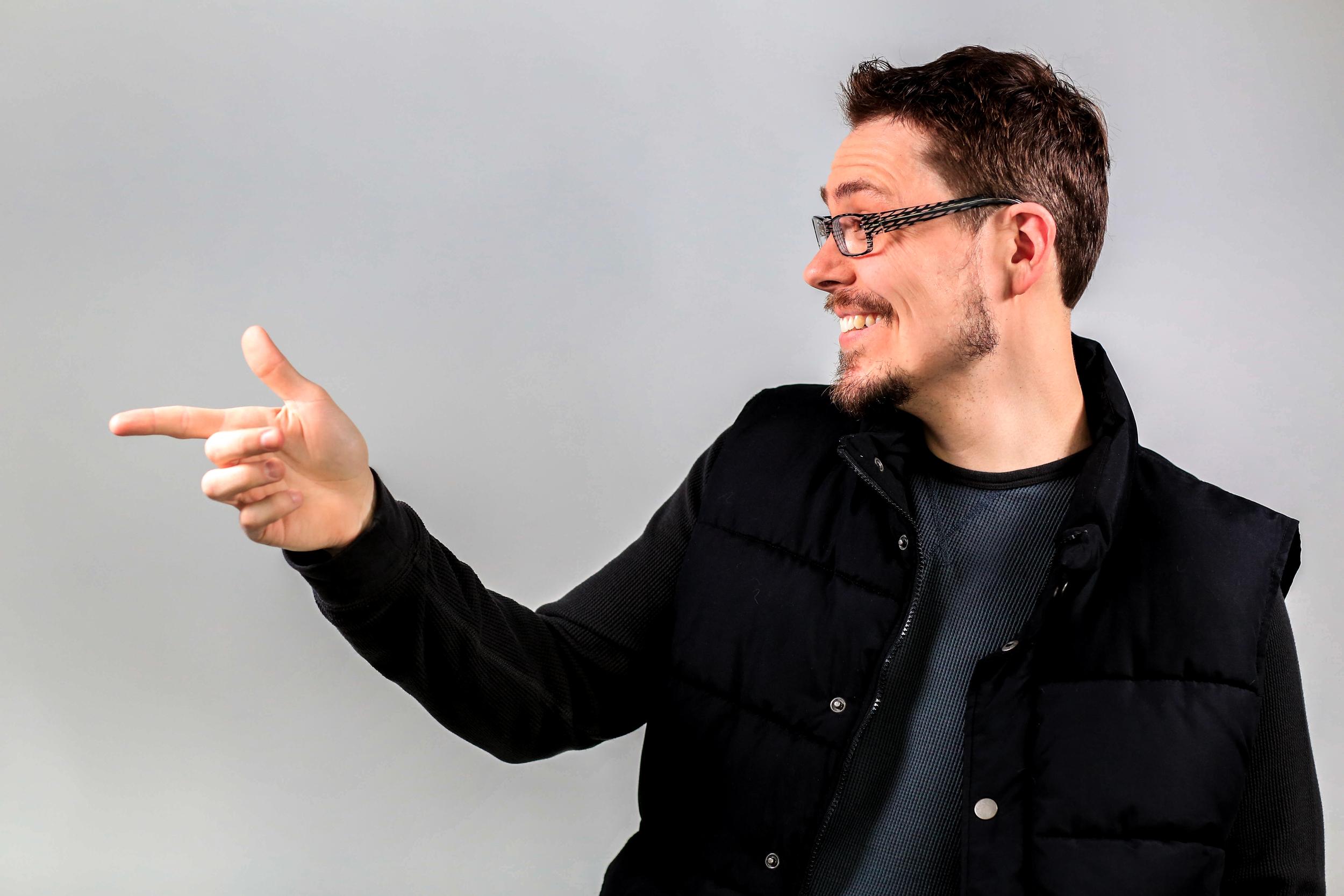 Josh isn't pointing. He's just waving.