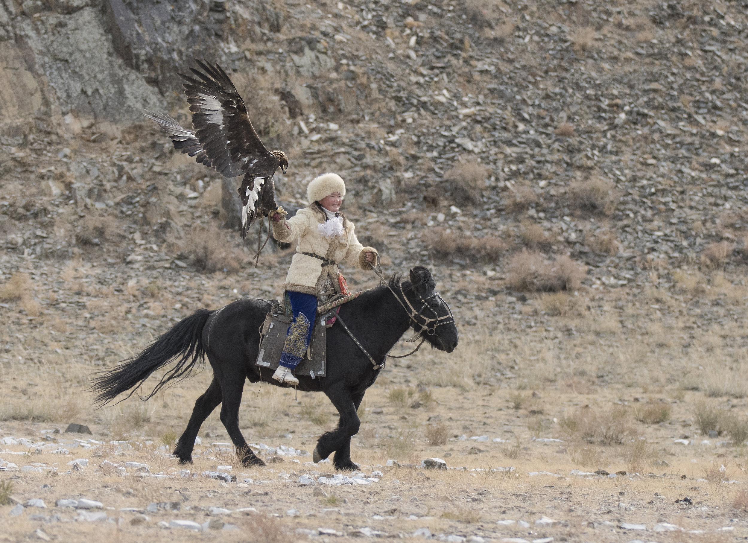 eagle huntress catches her eagle.jpg