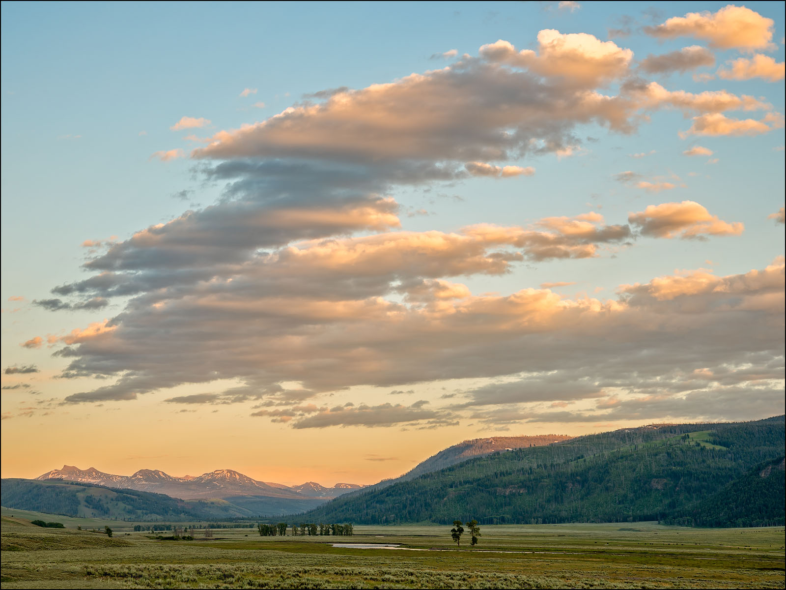 Sunset clouds over Lamar Valley, Yellowstone National Park, Wyoming.
