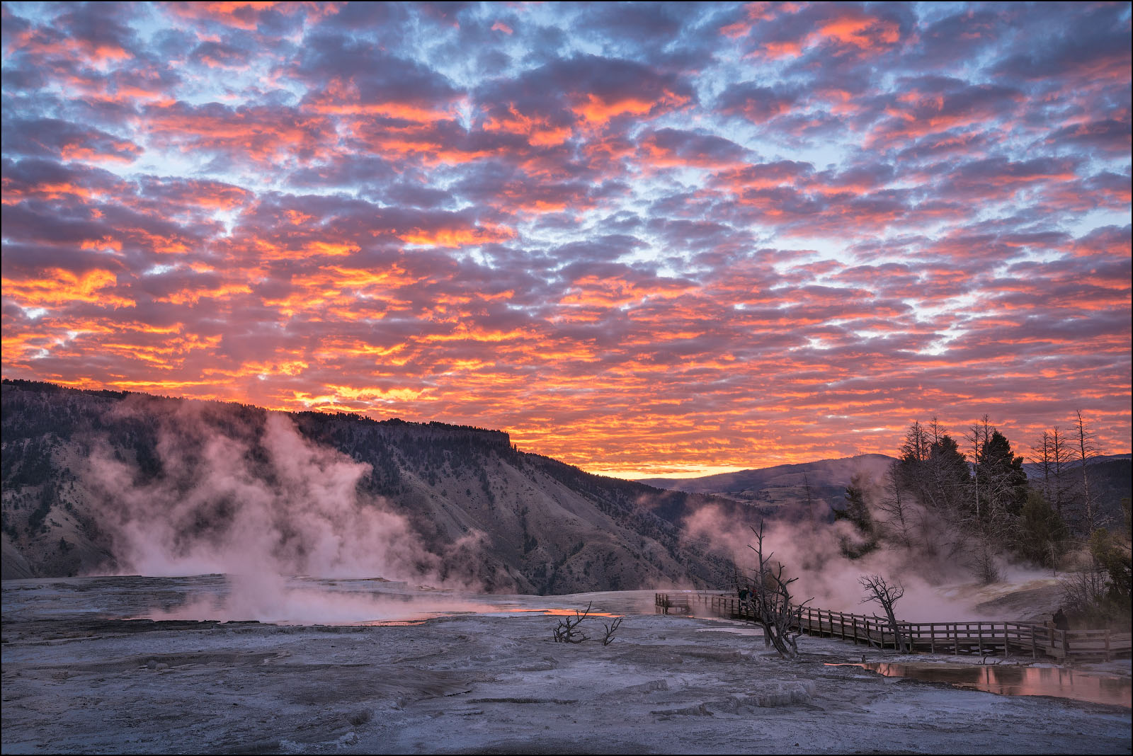 Sunrise clouds at Upper Mammoth Terrace, Yellowstone National Park, Wyoming.