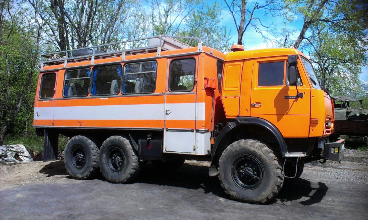Transportation between volcanoes by 6wd truck-bus.jpg