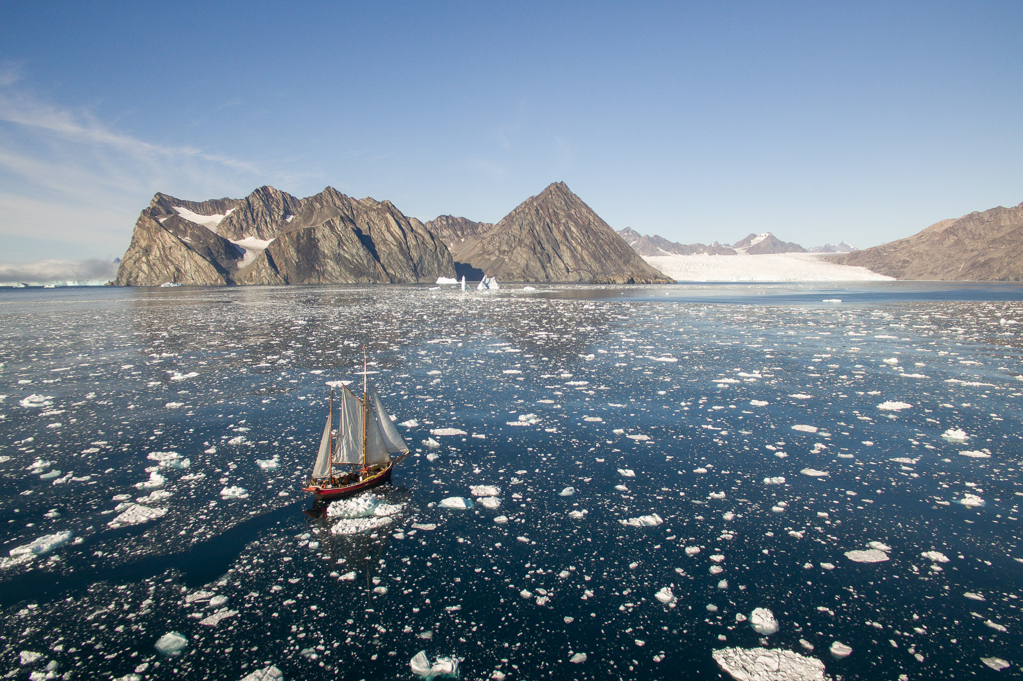 Expedition sailboat Arktika enters Tasiilaq fjord in east Greenland.
