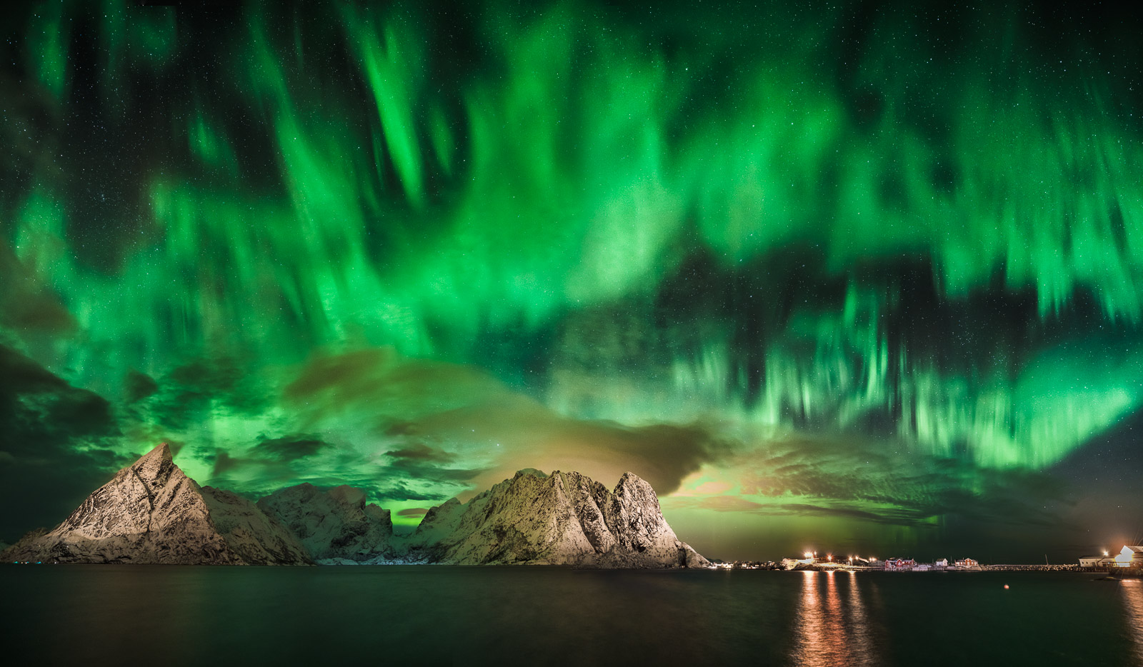Northern Lights over Olstind and Festhelltinden peaks, Reine Norway