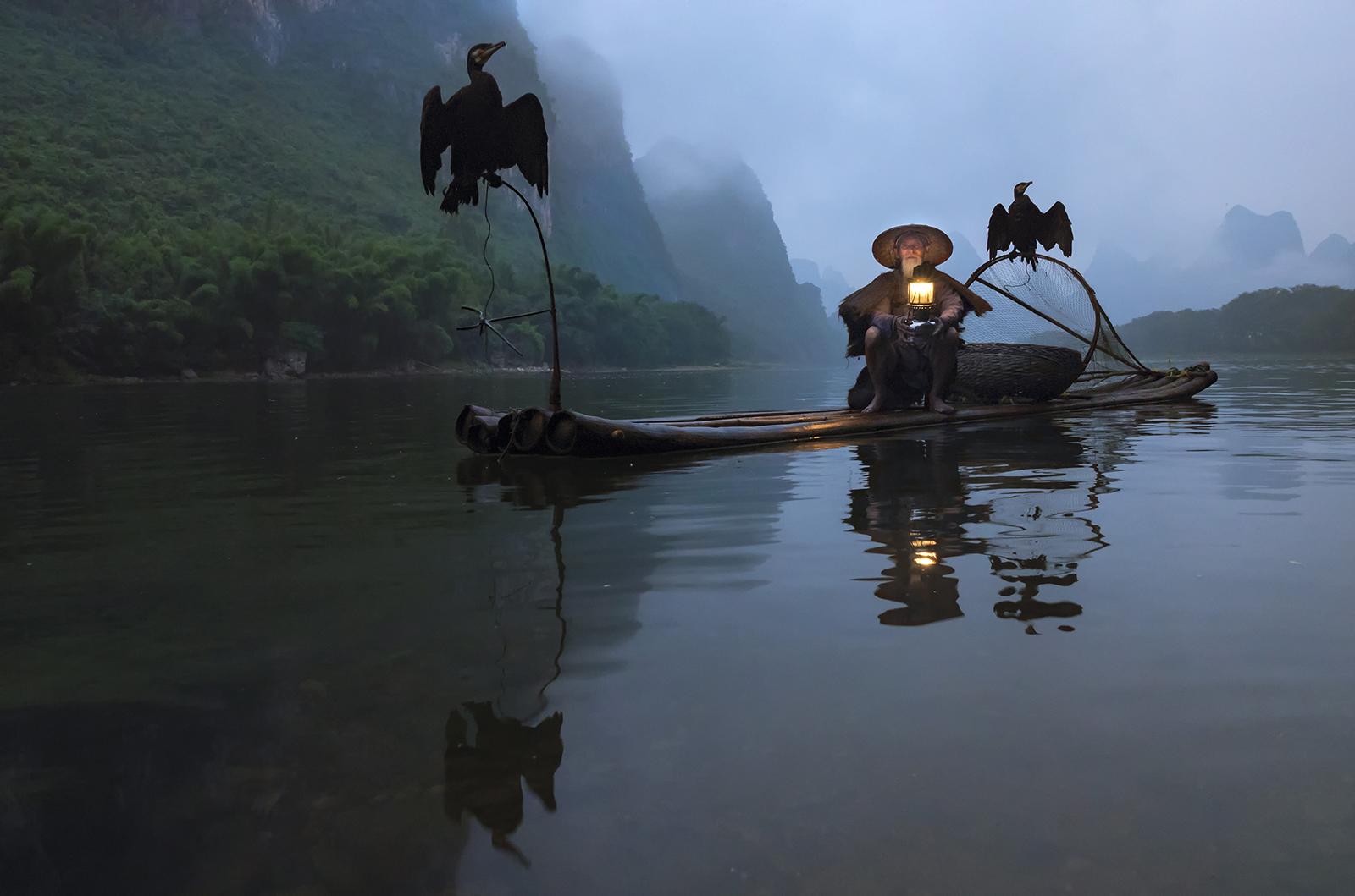 cormorant fisherman in teh morning.jpg