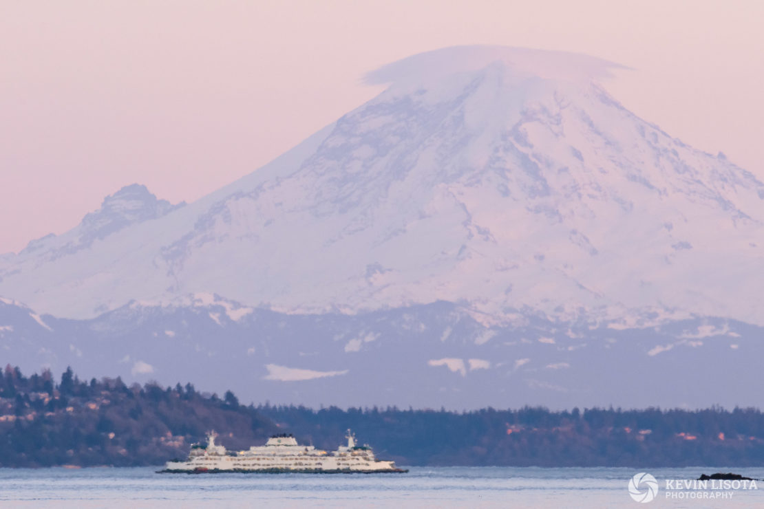 Heat distortion is more prevalent near ground level. Notice the strong heat waves above the water, but a sharper view of Mt. Rainier above those heat waves.