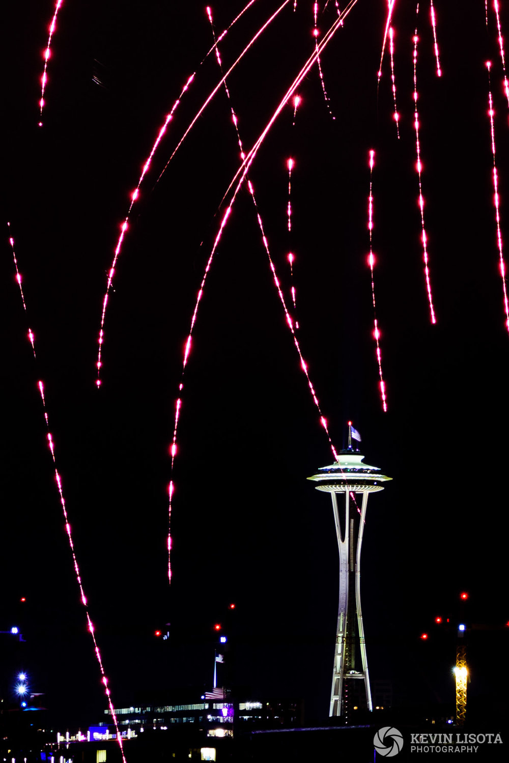 Fireworks fall in front of Seattle's Space Needle. Nikon D810, 70mm (cropped), 6.0″, f/9.0, ISO 200