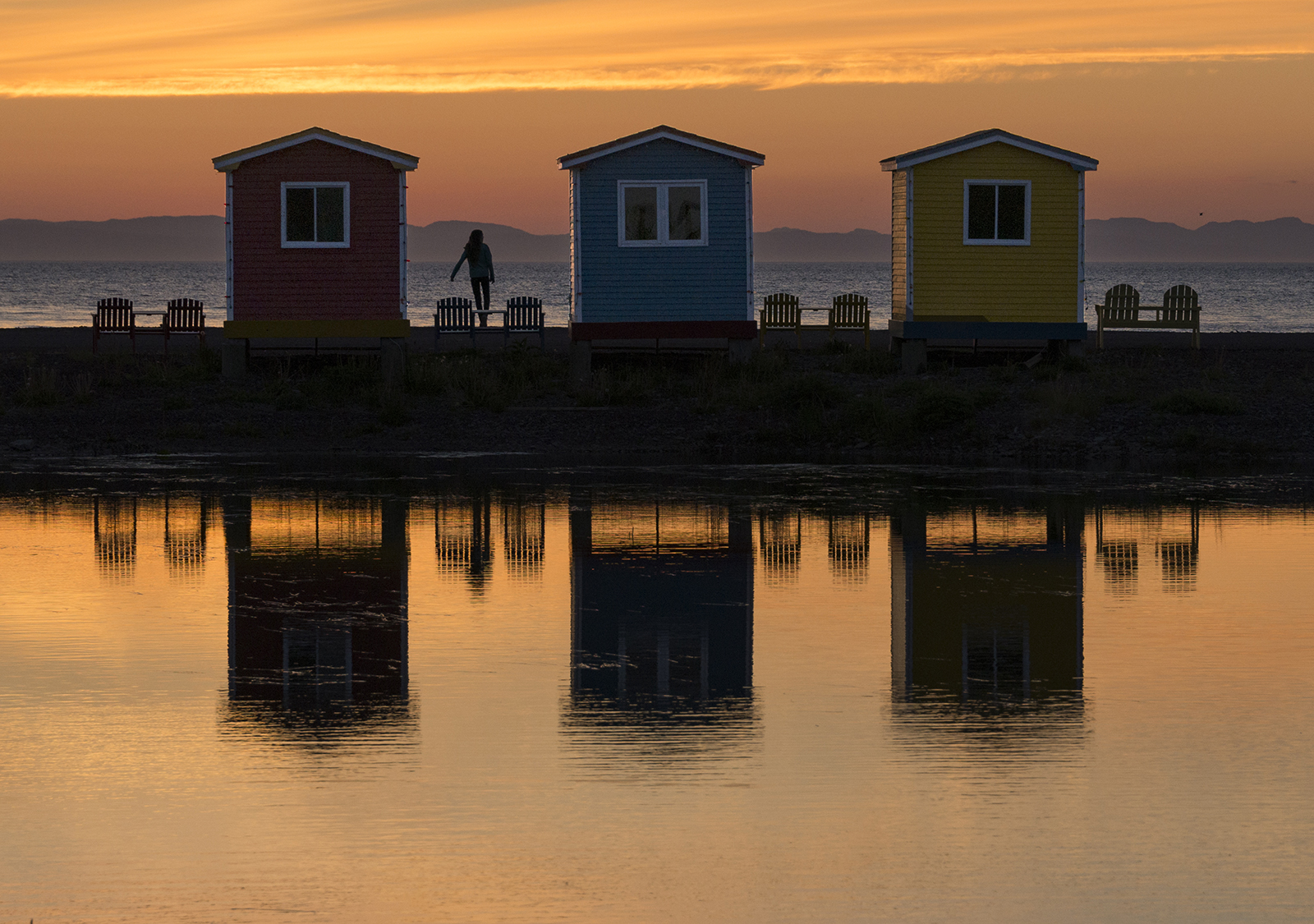 cavendish fishing huts with girl in photo.jpg