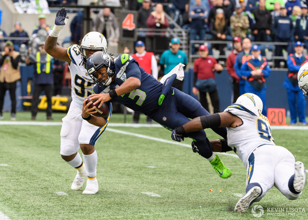 Russell Wilson dives for more yardage
