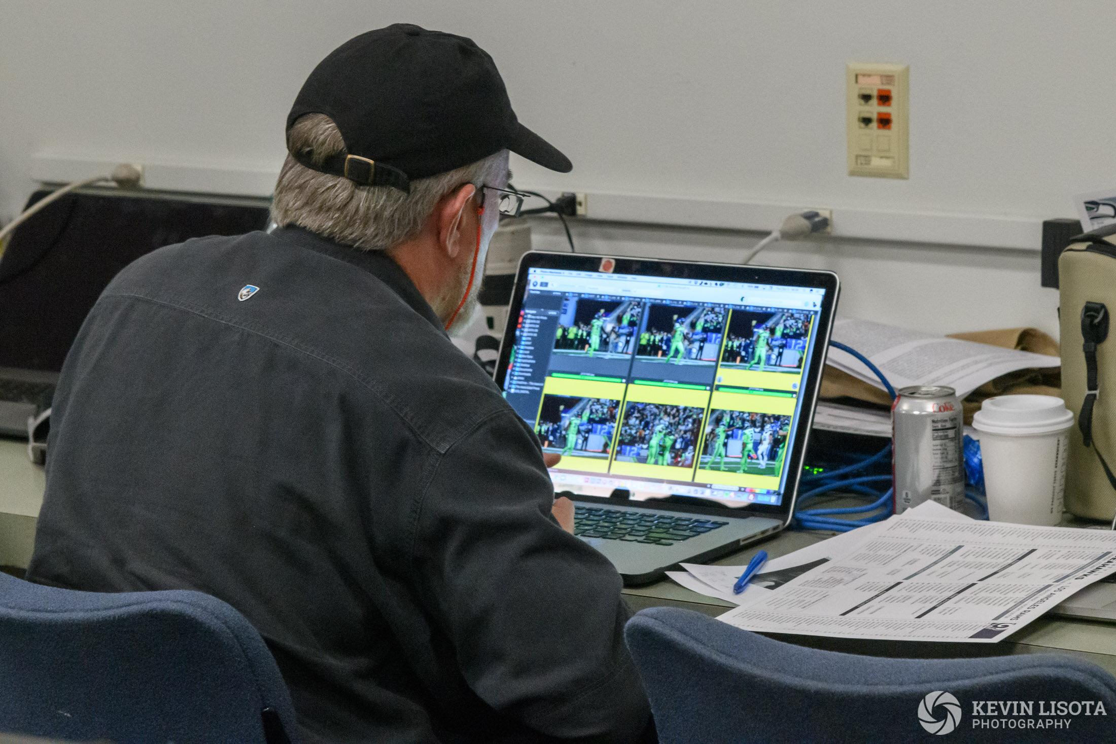 Photographer culls game photos using Photo Mechanic.