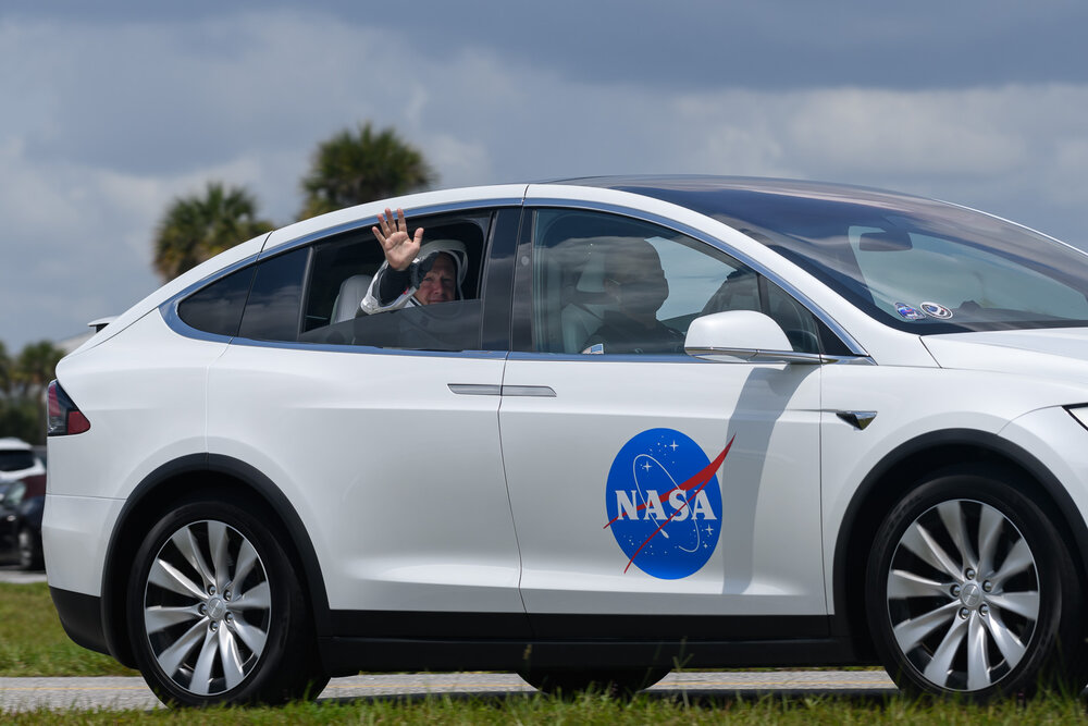 NASA astronaut Doug Hurley travels to Launch Complex 39A aboard a Tesla.