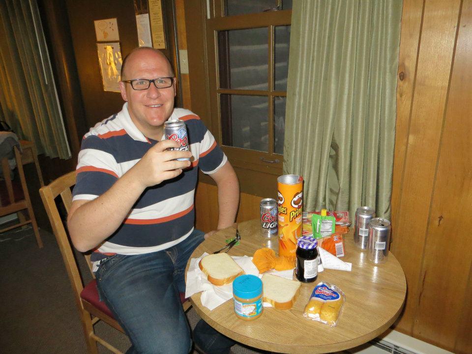 Dan is enjoying our picnic dinner.
