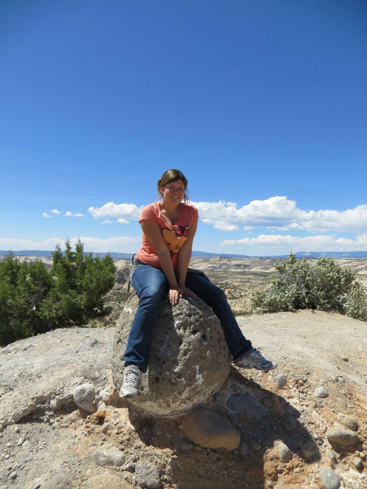 Sitting on a rock during a rest stop.