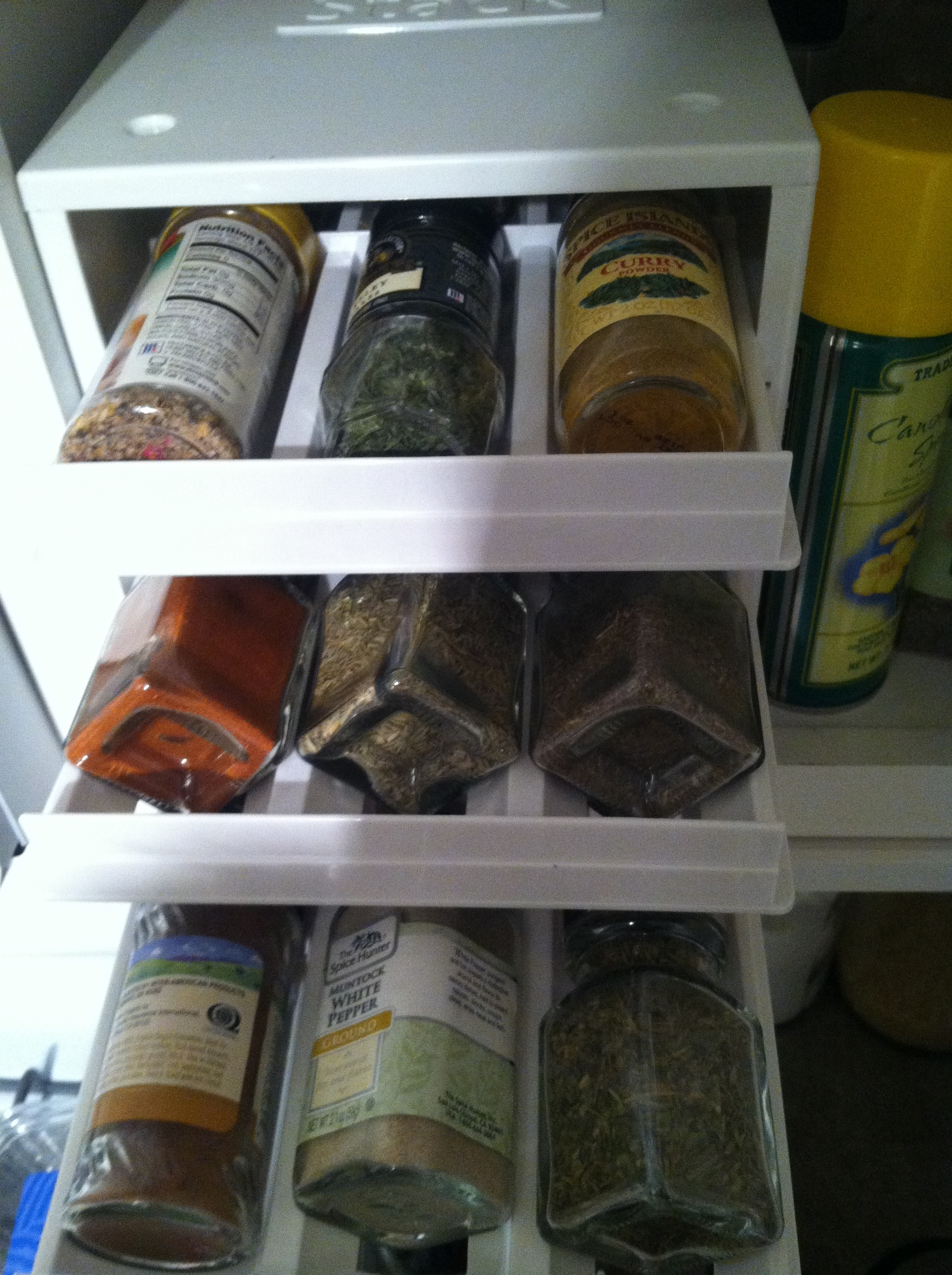 The spice drawer with everything open. This unit also comes in a bigger size, holding more jars and each cubby for the spice is big enough to accommodate various shapes and sizes.