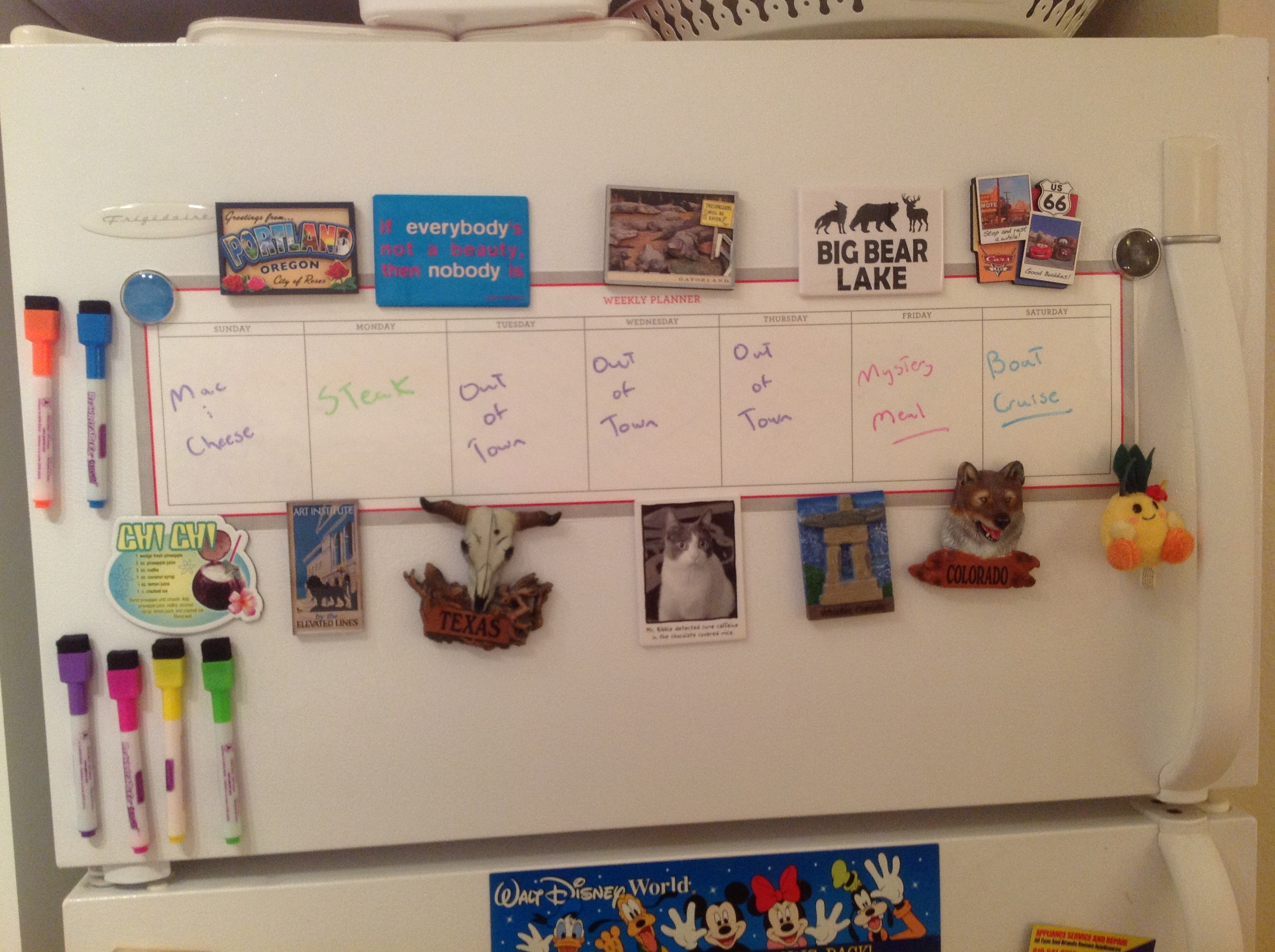 Our Martha Stewart week board. Unfortunately, it's not magnetic, so we used our magnet collection to hold it up. Please don't judge the meal choices or messy writing!