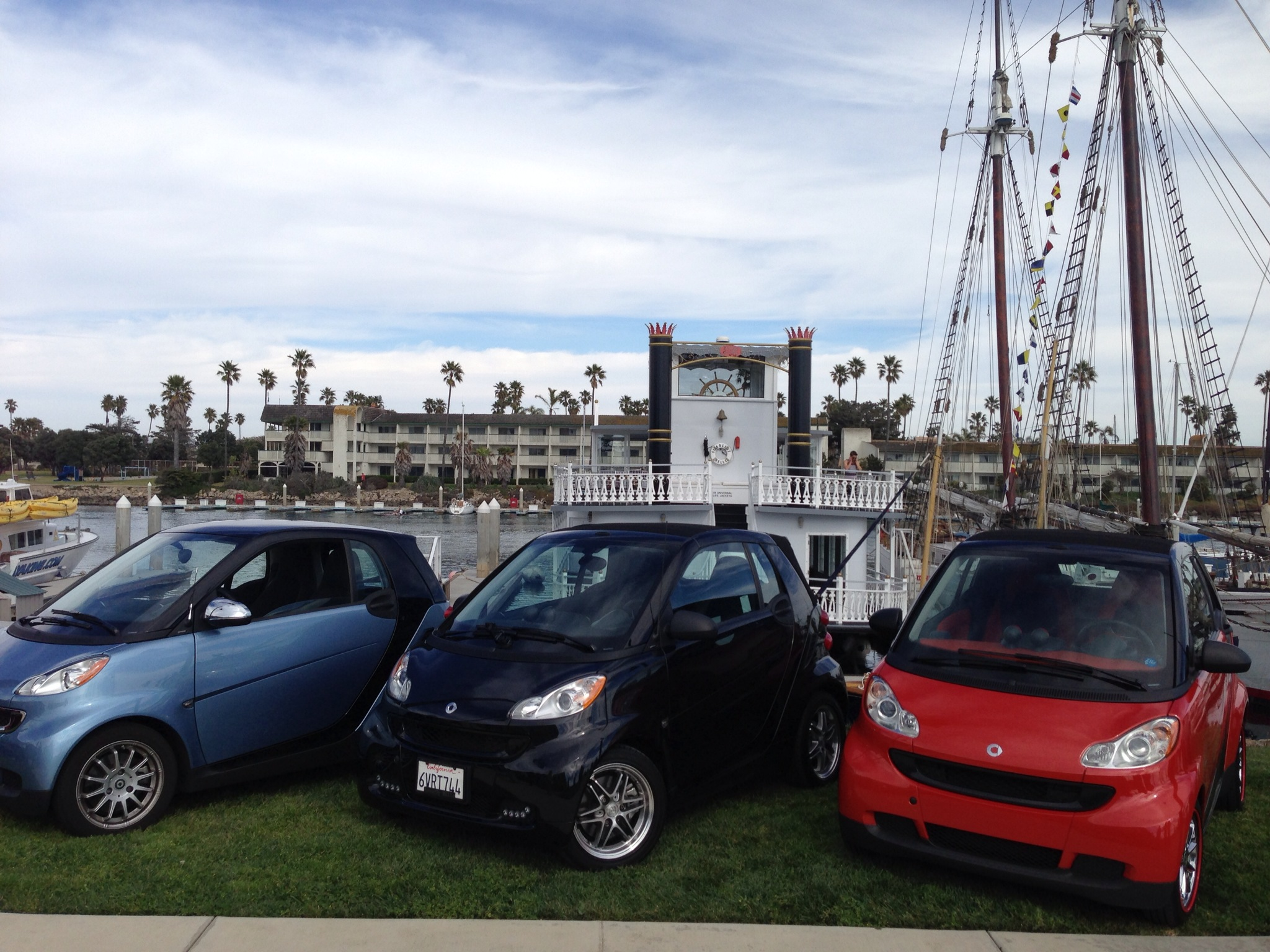 Our Smart (Black one in the middle) in front of our boat, The Scarlett Belle