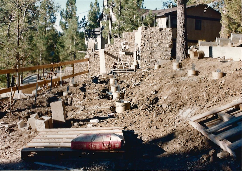 This photograph shows the entire location of the deck foundation with main staircase, basically finished. The other half of the staircase will be completed in wood as part of the deck construction.