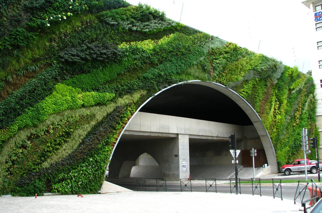 green and grey, concrete meets vertical gardens in France.