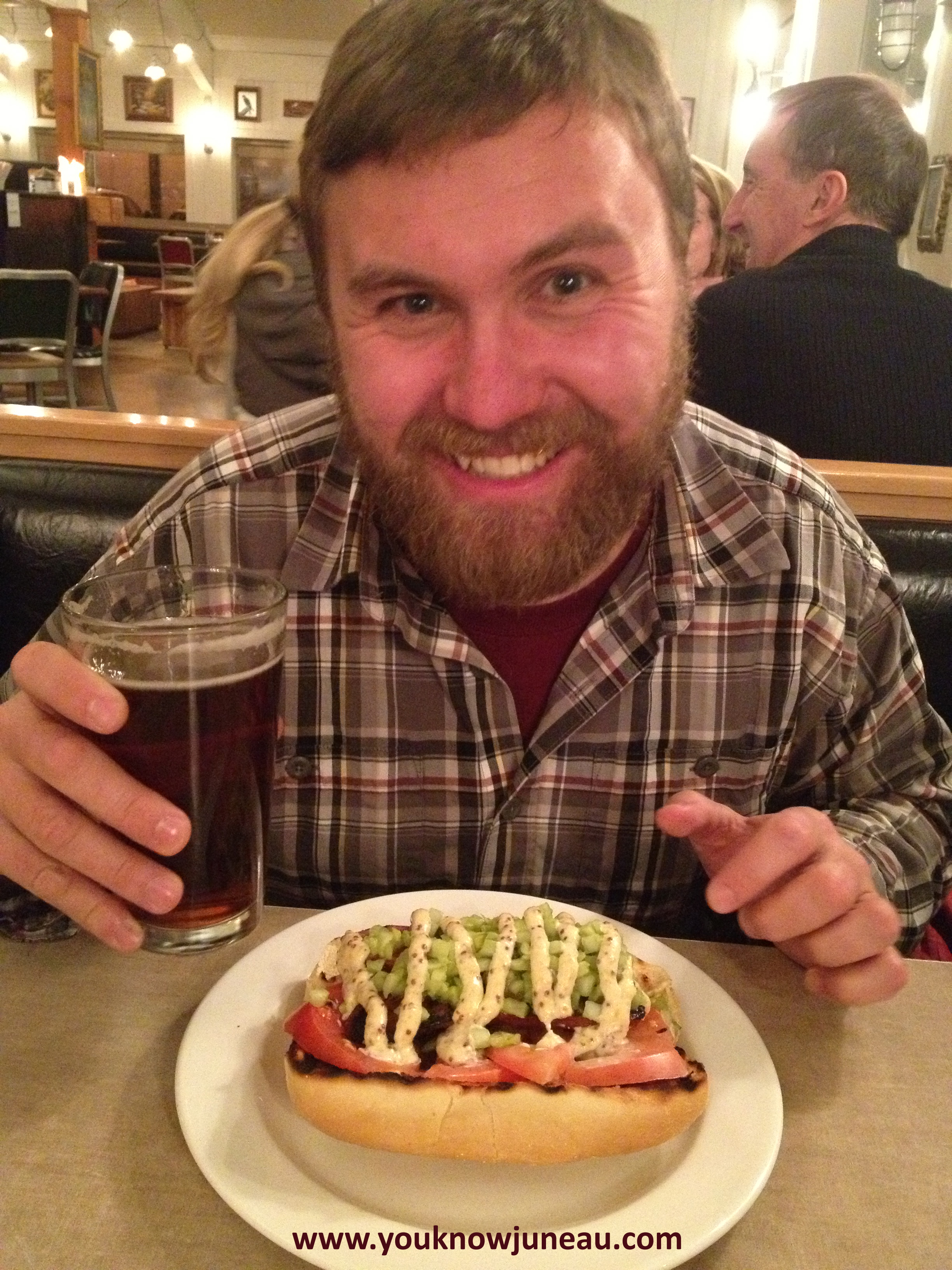 """My friend, Ben, demonstrates his excitement for the deal of the decade: the Spenard Roadhouse's """"Polish and a Pint."""" (Note the beard and flannel, trademarks of a typical Alaskan man!)             Normal     0                     false     false     false         EN-US     X-NONE     X-NONE                                                                                                                                                                                                                                                                                                                                                                                                                                                                                                                                                                                                                                                                                                             /* Style Definitions */  table.MsoNormalTable {mso-style-name:""""Table Normal""""; mso-tstyle-rowband-size:0; mso-tstyle-colband-size:0; mso-style-noshow:yes; mso-style-priority:99; mso-style-parent:""""""""; mso-padding-alt:0in 5.4pt 0in 5.4pt; mso-para-margin-top:0in; mso-para-margin-right:0in; mso-para-margin-bottom:10.0pt; mso-para-margin-left:0in; line-height:115%; mso-pagination:widow-orphan; font-size:11.0pt; font-family:""""Calibri"""",""""sans-serif""""; mso-ascii-font-family:Calibri; mso-ascii-theme-font:minor-latin; mso-hansi-font-family:Calibri; mso-hansi-theme-font:minor-latin;}"""