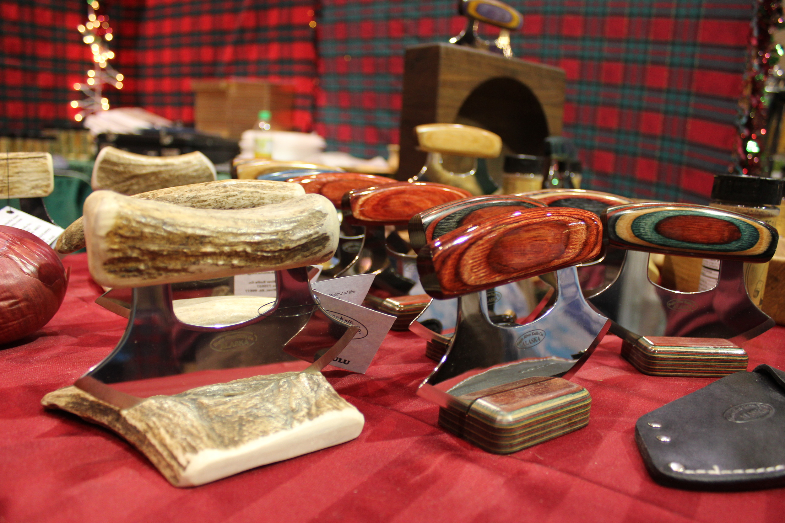Antler and wooden handled     ulus from   the  Eagle River Knife Co .