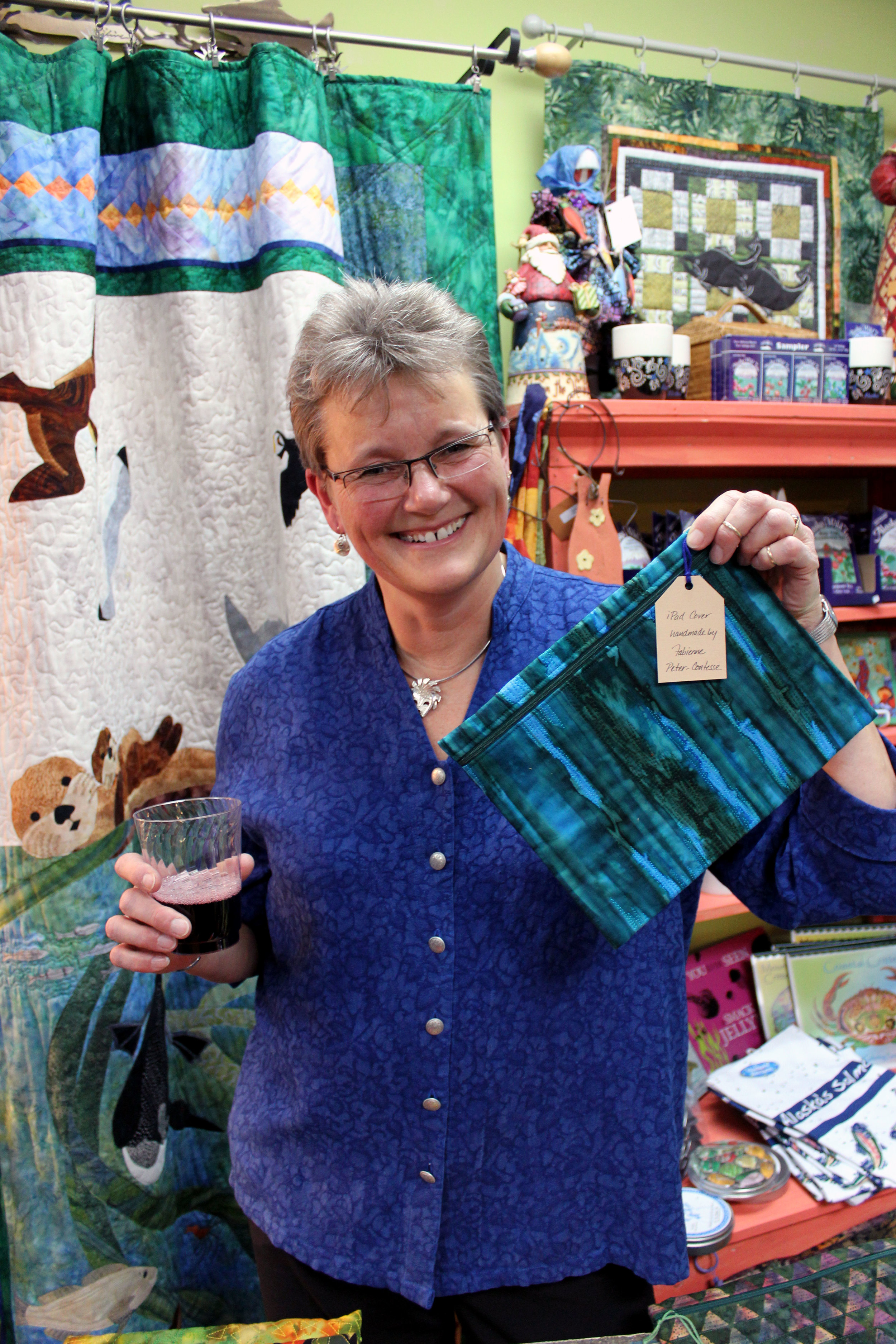 The artist and one of her hand-stitched iPad cases.