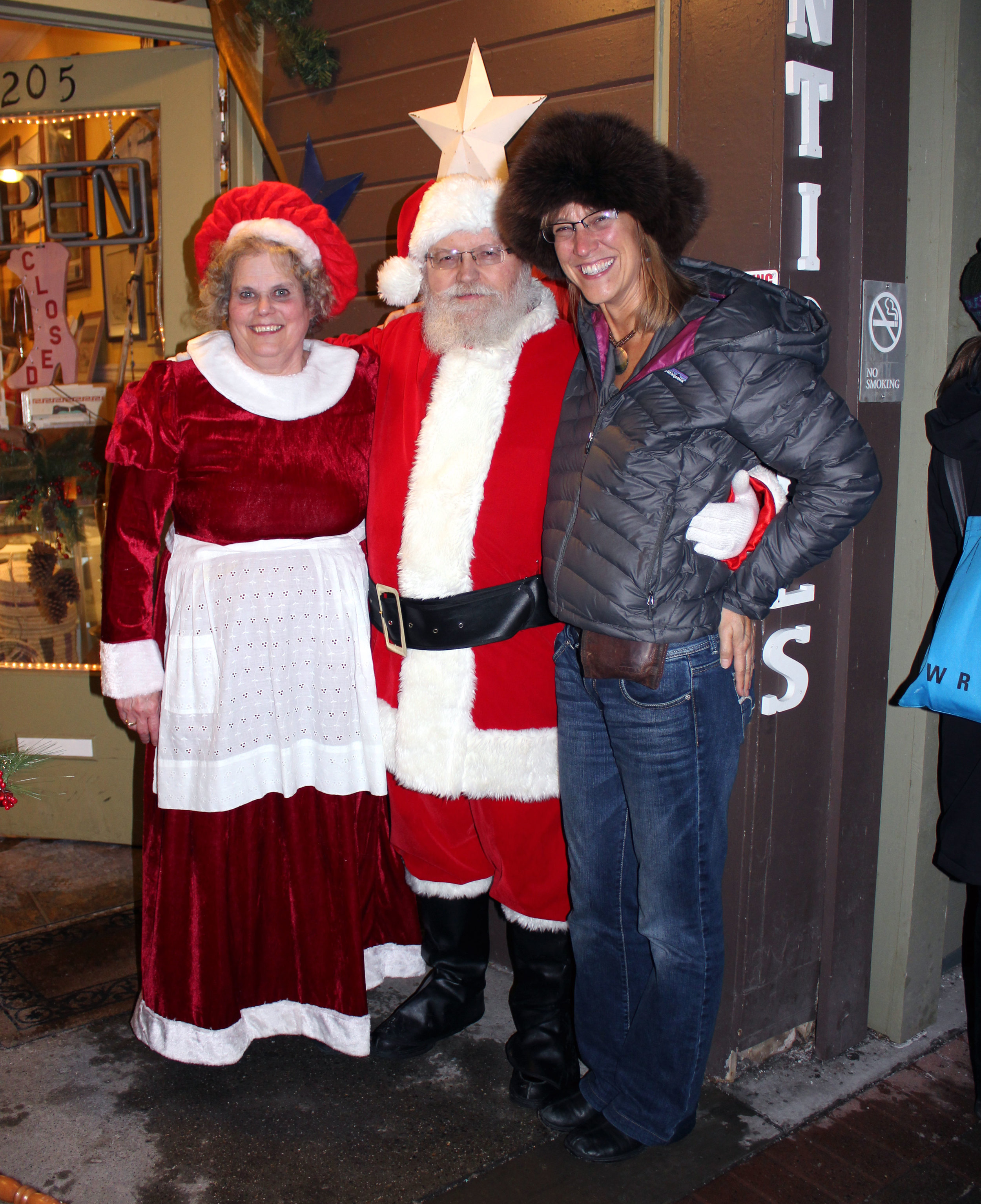 Michelle with Santa, Mrs. Claus, and The Hat.