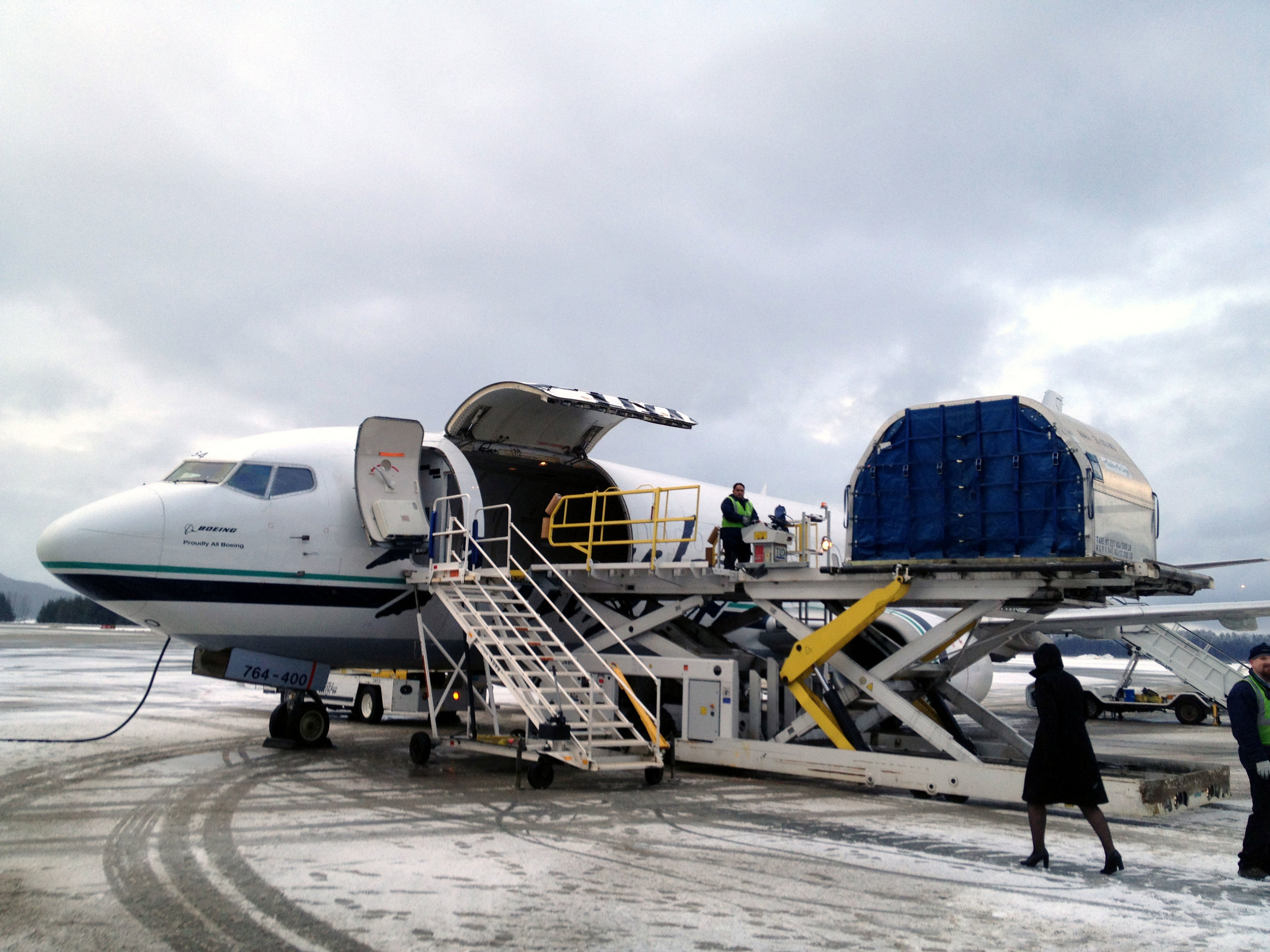 All aboard  the Boeing 737-400  Combi      aircraft in  Juneau! This is a combination cargo and passenger aircraft with all passengers way in the back.