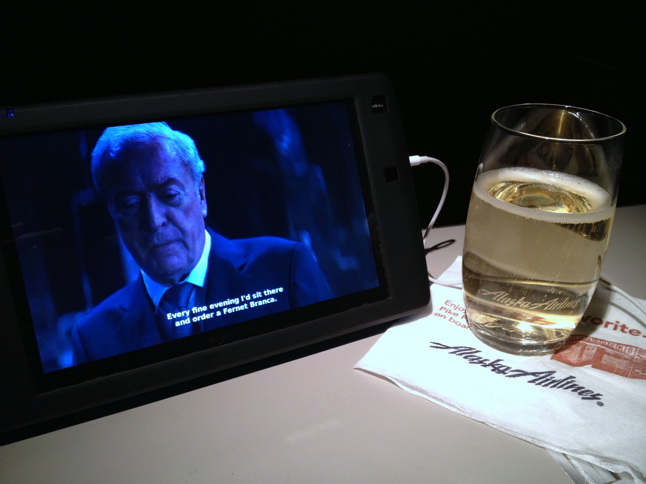 """Watching """"The Dark Knight Rises"""" and drinking champagne during my red-eye flight to Atlanta."""