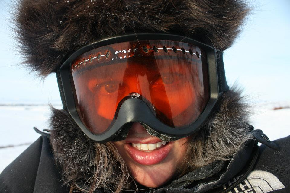 Donning ski goggles for my first snowmachine ride in Alaska.