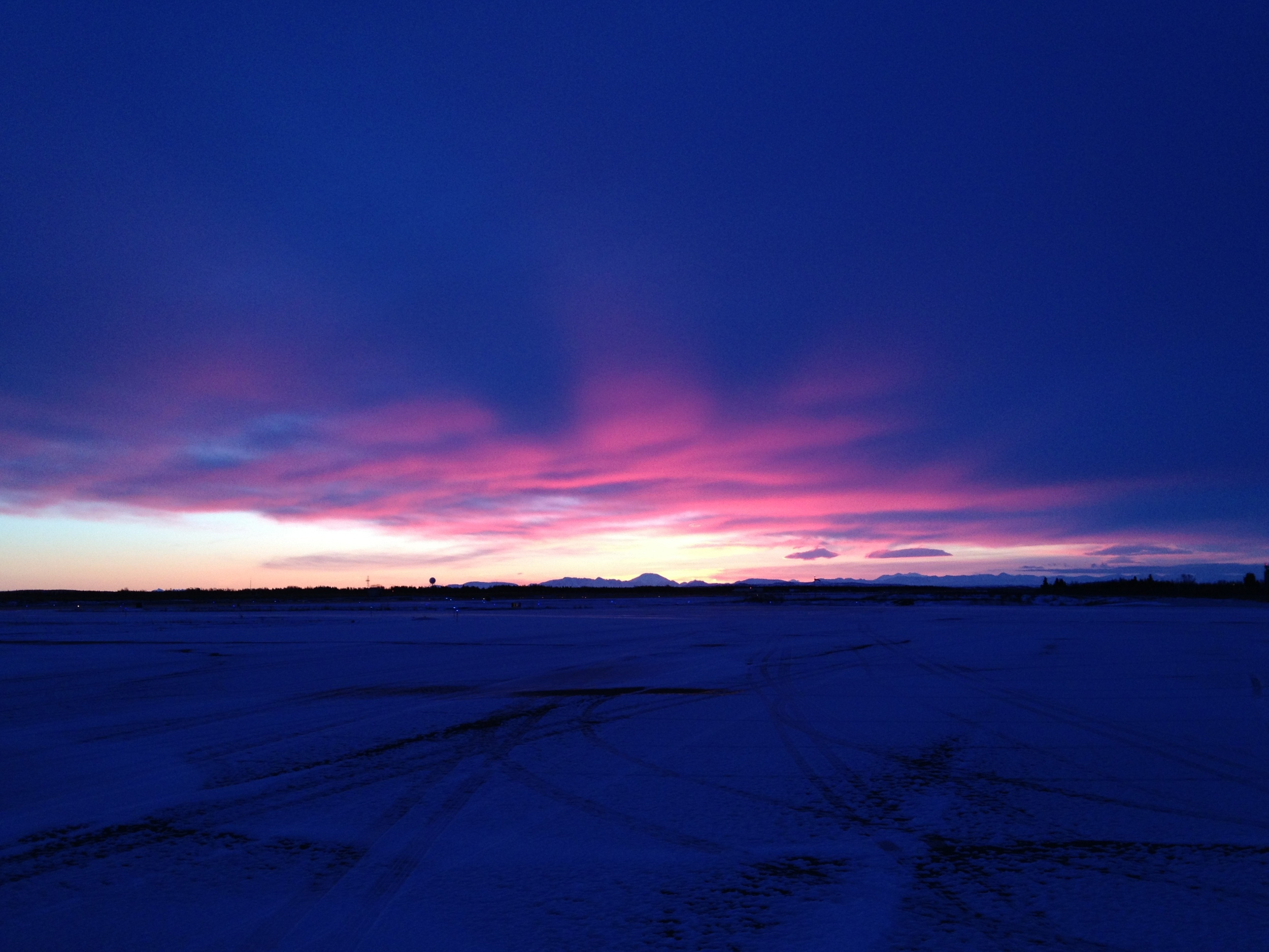 This is an unretouched photo taken with an iPhone 4S. This sunrise really was that amazing.