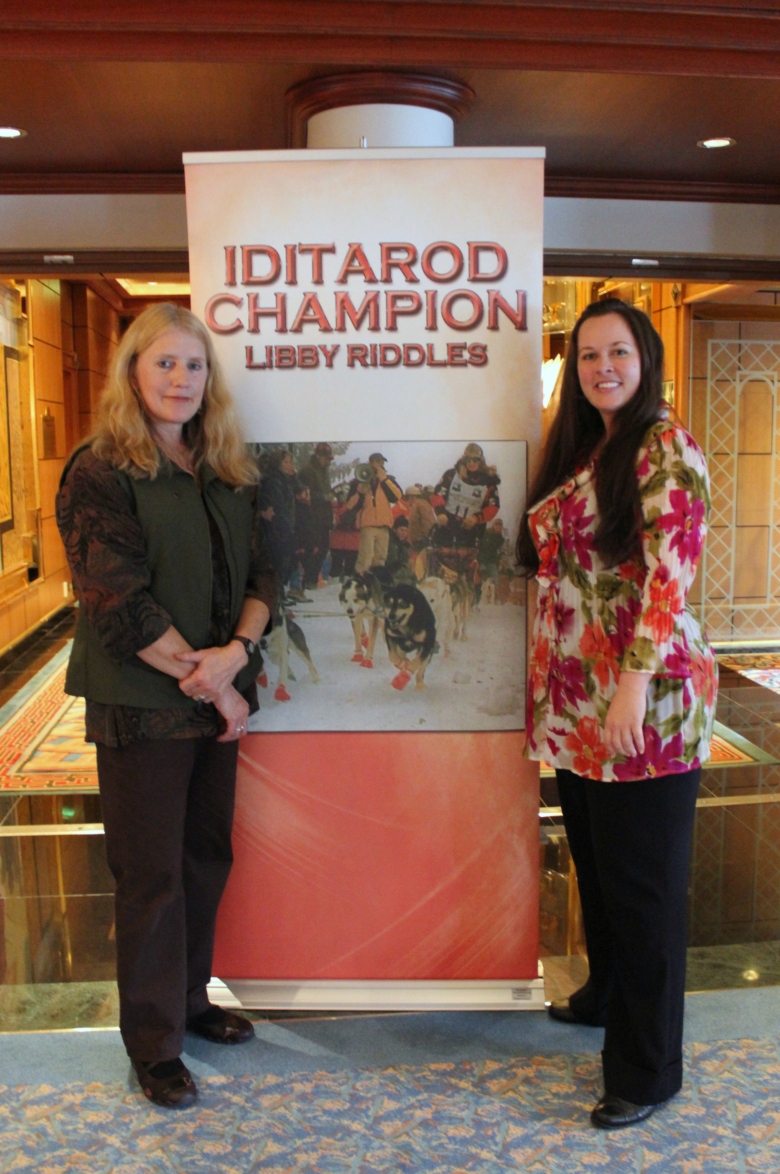 With Libby Riddles, the first female to win the Iditarod Trail Sled Dog Race. We met aboard a cruise ship in Juneau when she was presenting to tourists about the Last Great Race.